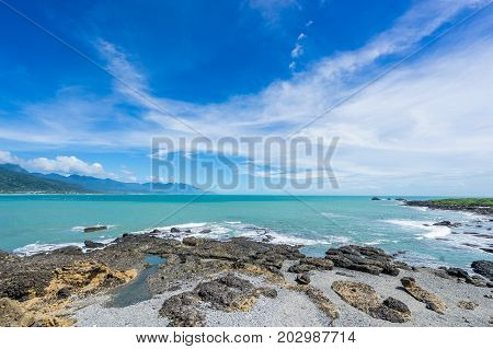Panoramic view of beautiful sea level with reef rocks under fantasy blue cloudy and sunshine sky in Sansiantai Taitung Taiwan