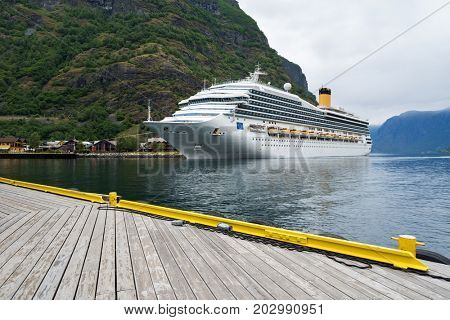 Cruise liner in the fjord of Aurlandsfjord near the village of Flam, Norway