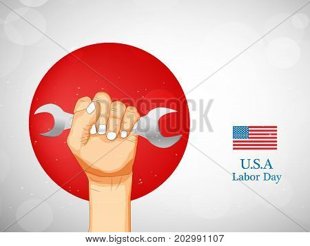 illustration of hand holding spanner and usa flag with U.S.A. Labor Day text on the occasion of Labor Day