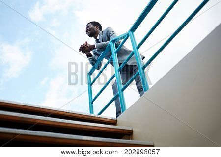 Posh businessman in suit traveling by yacht or ship