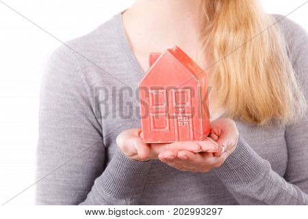 Housing property ownership real estate construction finances concept. Person holding house model. Human presenting building symbol.