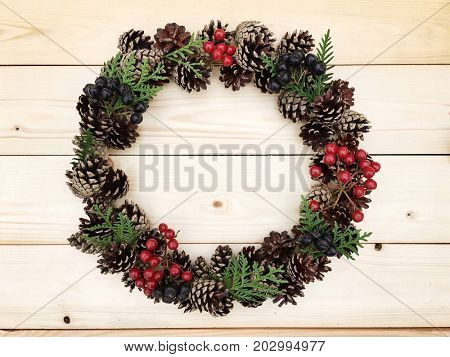 Christmas wreath on the wooden background