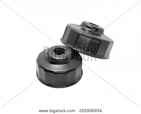 Oil Filter Wrench Cup Type Top view of Black oil filter wrench removal tools with a two size for engine oil maintenance tools isolated on white background. Automotive tools concept.