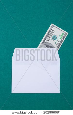cash in an envelope on a green background