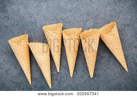 Flat Lay Ice Cream Cones Collection On Dark Stone Background . Blank Crispy Ice Cream Cone With Copy
