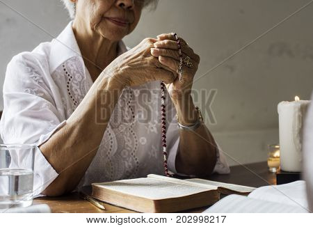Senior woman prayer faith in christianity religion
