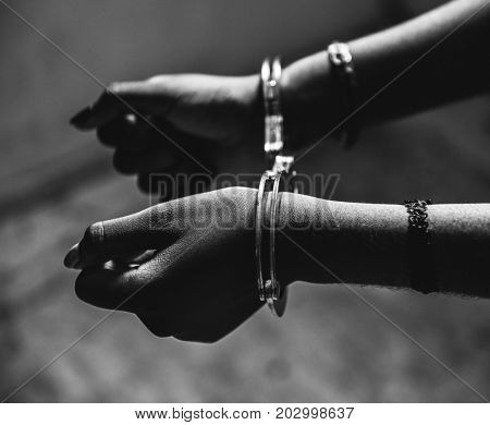 Hands arrested with a handcuff
