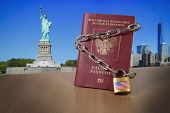 Russian foreign passport with metal chain and lock. USA Department of State blocked limited US visa issue for Russian people. US Anti russian sanctions. Sanctions campaign propaganda illustration poster