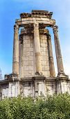 Temple of Vesta Corinthian Columns Roman Forum Rome Italy. This temple was built in the 300s AD but there has always been a Temple of Vesta. 10 Virgins were required to keep the fire buring at the temple on penalty of physical punishment. poster