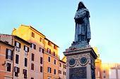 Monument to Giordano Bruno at Campo dei Fiori in central Rome at sunset poster