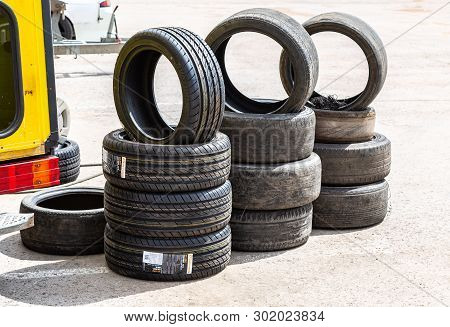 Samara, Russia - May 18, 2019: New And Used Car Tires Stacked Up On Road