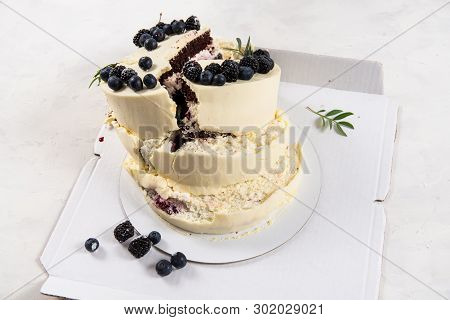 Broken Cake On White Background. Bad Birthday, Wedding. Spoiled Holiday. Bad Luck, Bad Delivery Conc