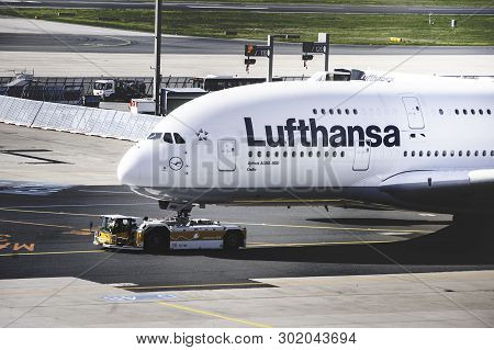 Frankfurt Airport, Germany, April 2019. The Front Of The Huge Airbus A380 Of Lufthansa.