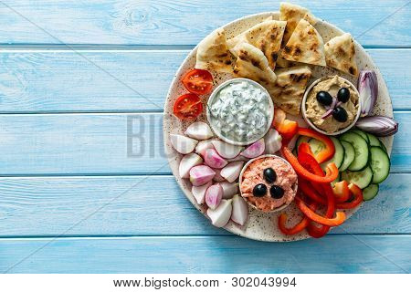 Selection Of Traditional Greek Food - Salad, Meze, Pie, Fish, Tzatziki, Dolma On Wood Background, To