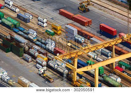 Barcelona, Spain - April 8, 2019: Aerial View On Industrial Port Mare Combinato Sl. Trucks, Load, Ra