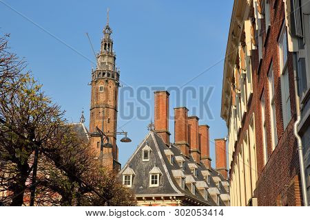 Traditional Houses On Grote Markt Square With The Tower Of The Town Hall (stadhuis) On The Left, Gro