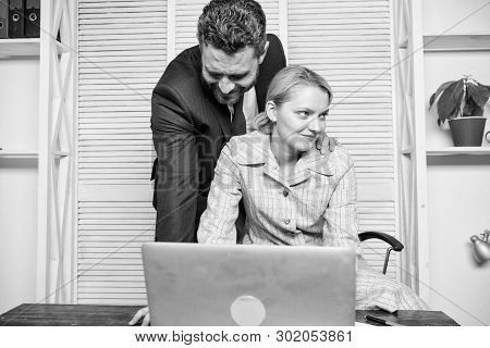 Create Greater Safety And Trust. Sexual Harassment At Work. Man And Woman Colleagues Flirt In Office