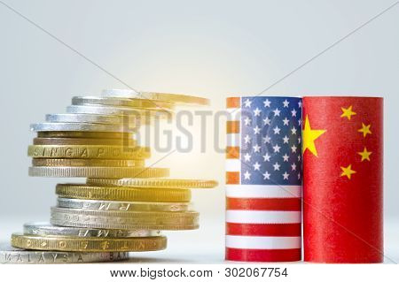 Usa Flag And China Flag With Coins Stacking For Tariff Trade War And Tech War Between United States
