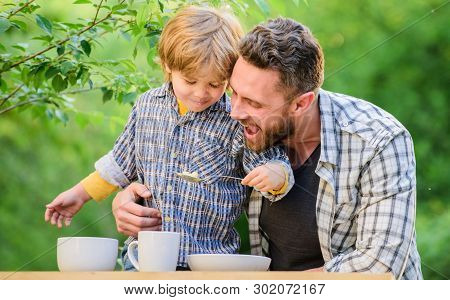 Childhood Happiness. Happy Fathers Day. Little Boy With Dad Outdoor. Healthy Food And Dieting. Famil