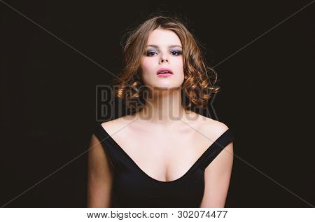 Beauty Salon Concept. Woman With Curly Hairstyle And Makeup On Black Background. Makeup Idea For Ele