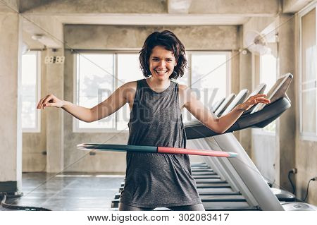 Beautiful Young Smiling Happy Caucasian Sporty Woman With Short Hair Playing Hula Hoop Inside Gym St