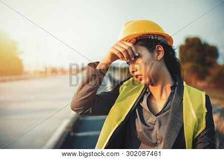 Engineer Women Wipe Sweat And Hot Weather At Site Construction.