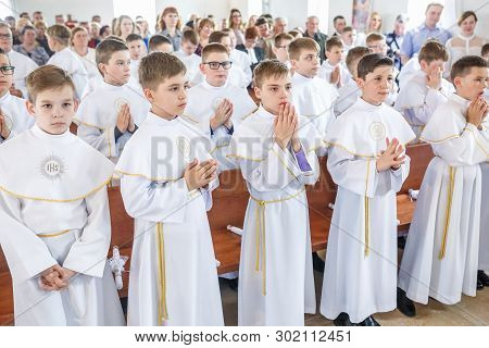 Grodno, Belarus - May 2019: Young Children In The Catholic Church Are Waiting For The First Eucharis