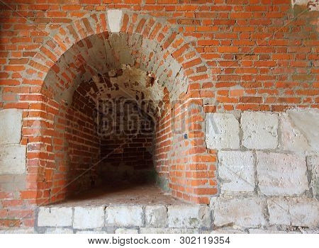 Medieval Wall From Red Brick And White Limestone With Embrasure St. Nicholas Gate Tower Of The Zaray