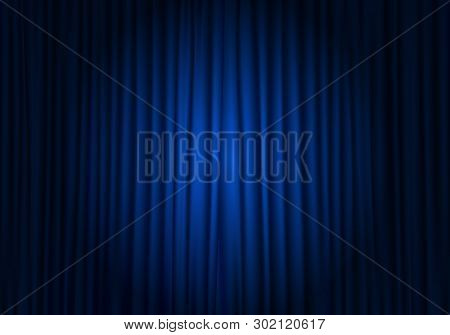 Spotlight On Stage Curtain. Closed Blue Curtain Background. Theatrical Drapes.