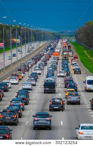 East Butovo, Moscow region, Russia - May, 6, 2019: weekend traffic jam on a highway in Moscow region, Russia before rainstorm