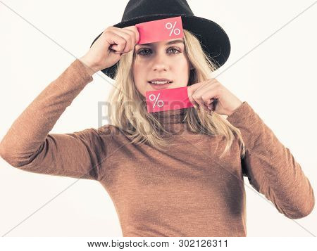 Woman In Hat Showing Tag With Shopping Sale Percentage Sign Enjoying Cheap Clothing. Female Wearing