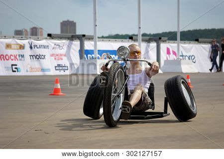 Moscow. Russia - May 20, 2019: A Man Rides At The Street On A Homemade Tricycle. On Trike. These Bor