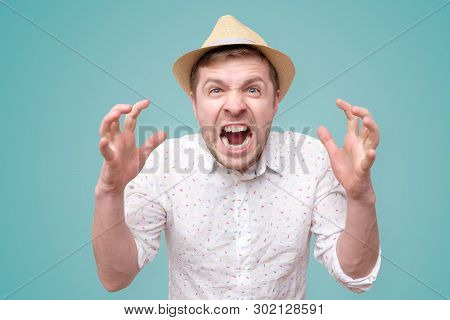 Furious, Enraged Man With Mouth Opened In Shout