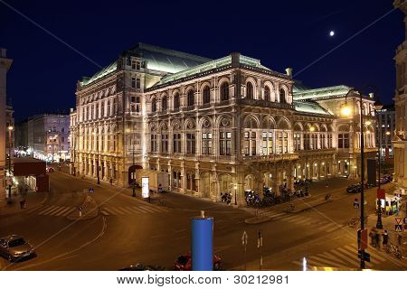 Vienna Austria - famous Staatsoper (State Opera) building at night. The Old Town is a UNESCO World Heritage Site. poster