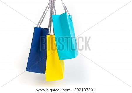 Paper Shopping Bags With Handles On White Background. Mockup For Design.