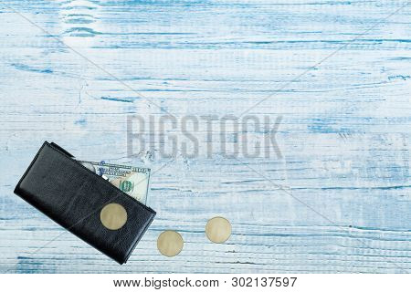 Leather Wallet With Dollar Bill On Wooden Table. Top View.