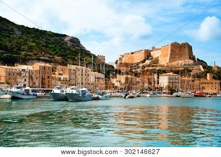 BONIFACIO, FRANCE - SEPTEMBER 19, 2018: A view over the port of Bonifacio, in Corsica, France, with the famous citadel of the city in the background, on the top of a promontory