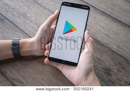 Chiang Mai, Thailand - May 11,2019 : A Man Holds Oneplus 6 With Google Play Application On The Scree