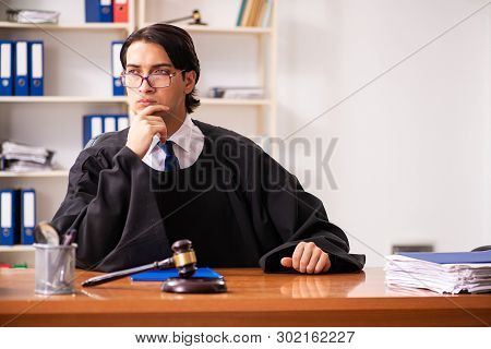 Young handsome judge working in court