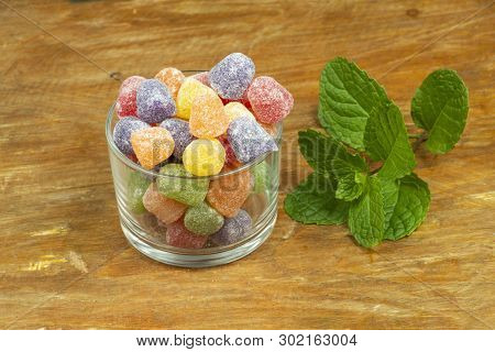 Glass Jar With Jam Of Jujube On A Wooden Table