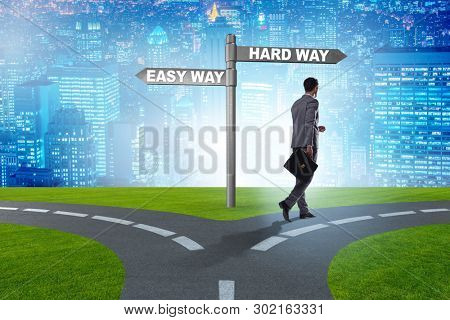Businessman choosing between hard and easy way