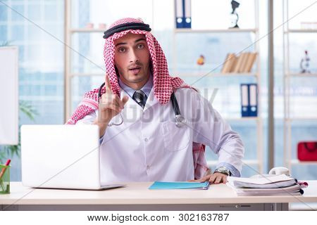 Arab doctor working in the clinic
