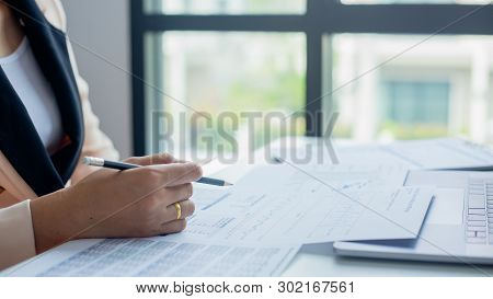 Businesswoman Calculate About Cost And Doing Finance At Office, Finance Managers Task,concept Busine