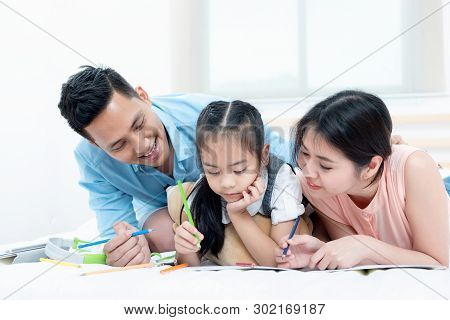 Asian People, Happy Family In Bedroom At Home. Mother, Father And The Children Playing, Activities O