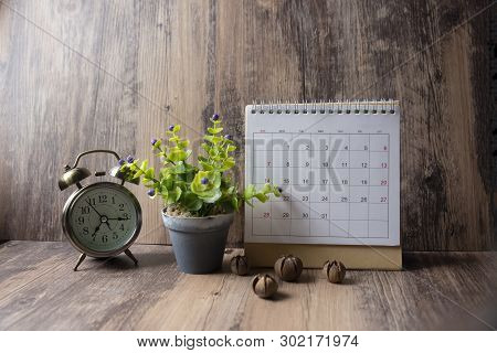 Desktop Calendar 2019 And Vintage Clock Place On Wooden Office Desk.calender For Planner Timetable,a