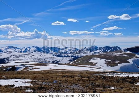 Rocky Mountain National Park Landscape With Snow Capped Peaks And Alpine Meadows.  Trail Ridge Road