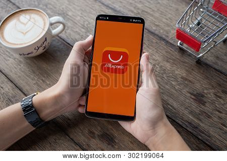Chiangmai, Thailand - May 11, 2019: Male Holding Oneplus 6 With Internet Shopping Service Aliexpress