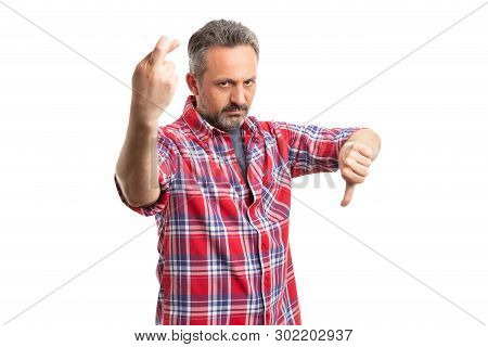 Angry Man Making Bad Luck And Dislike Gesture With Crossed Fingers Thumb Down Isolated On White Back