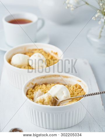 Apple Crumble With Ice Cream, Spoon With Streusel. Side View, Vertical. Morning Breakfast On Light G