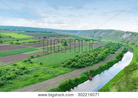 Aerial View Of Agricultural Fields With River Stock Photo